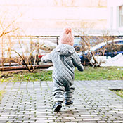Toddler running outside