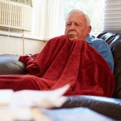 Old man under a blanket